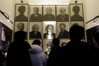 South Korea high school students look at portraits of late former