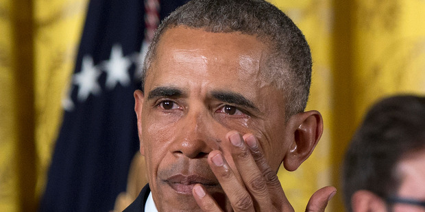 President Barack Obama wipes away tears as he speaks about steps to reduce gun violence. Photo / AP