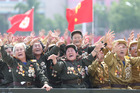 North Korean war veterans cry as they parade past their leader Kim Jong-Un. Photo / AP