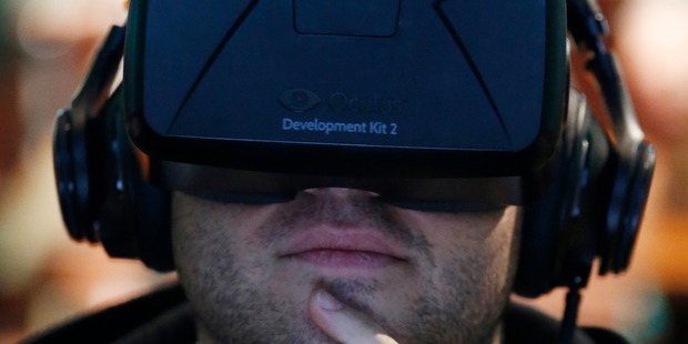 New York Jets fan Cory Teplitz watches a virtual reality video. Photo / AP