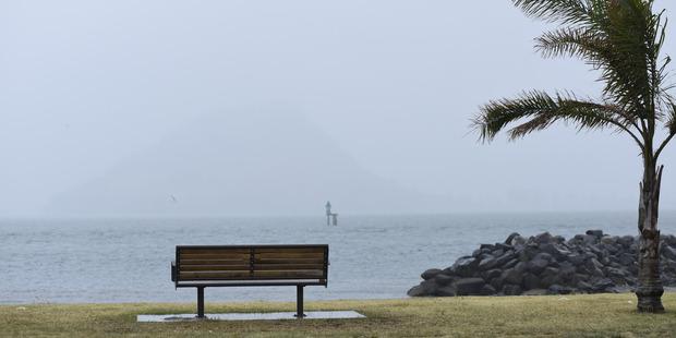Dreary weather descends on Pilot Bay. Photo / George Novak, Bay of Plenty Times