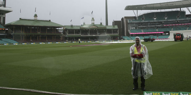 Rain left only security guards on the field. Photo / AP
