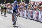 Rushlee Buchanan wins the women's elite road race. Photo: John Cowpland / alphapix