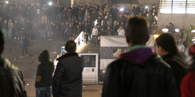 People gather at Cologne's main station on New Year's Eve. Photo / AP