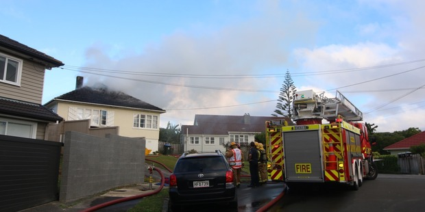 Firefighters are at the scene of a house fire in Westmere, Auckland