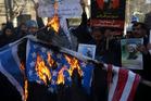 Iranian demonstrators burn representations of the US and Israeli flags during a demonstration in front of the Saudi Arabian Embassy in Tehran, Iran. Photo / AP