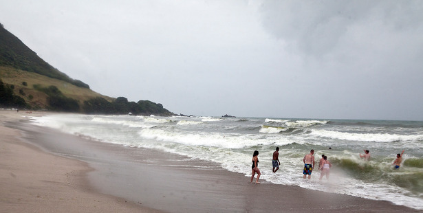 Wet Weather at the Mount. These Aucklanders decided to take a dip at the Mount Main Beach despite the rain. Photo/Andrew Warner.