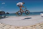 "Ben Gibson doing a ""Bar Spin"" in front of Whangapoua Beach Photo / John Gibson"