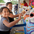 Jaylee, 4, and Harmony Rewita, 9, try their luck on the laughing clowns.
