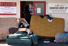 Gonville Hospice Shop store manager Sue Lumsden said the Tawa St shop is being used as a rubbish dump. Photo / Stuart Munro