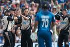 Trent Boult is congratulated on getting the wicket of Sri Lankan batsman Tillakaratne Dilshan. Photo / Alan Gibson