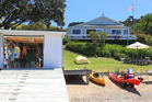 This Arran Bay, Waiheke Island getaway has it all: beach, boatshed and bach. Photo / Supplied