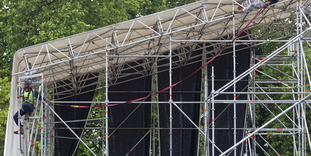 Workmen building the stage for UB40 concert at Rotorua's Village Green. PHOTO/STEPHEN PARKER