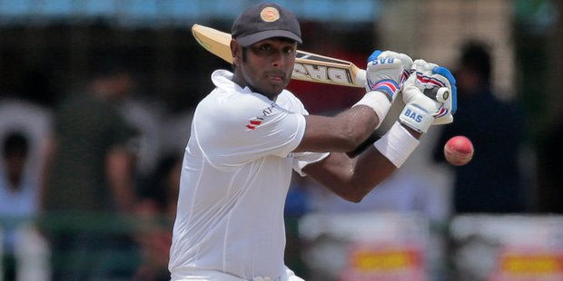 New Zealand knew Angelo Mathews stood between them and a series-clinching victory as the game rushed to its conclusion at Bay Oval yesterday. Photo / AP