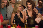 Amy Poehler and Tina Fey are in fine form as they throw a house party for their old high school friends. Photo / AP