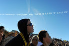 Spectators watch the sky-writing planes over the Rose Parade in California. Photo / AP