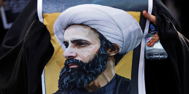 A Bahraini protester holds a picture of Saudi Shiite cleric Sheikh Nimr al-Nimr during a rally denouncing the execution of the Shiite cleric. Photo / AP