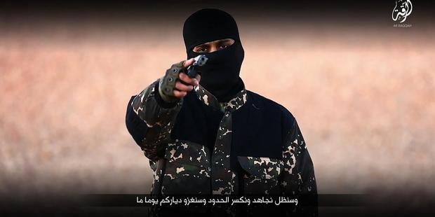 The gunman who fronts the latest Isis video speaks with an English accent and calls British Prime Minister David Cameron an imbecile. Photo / AP