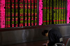China is trying to perform a balancing act to support the market and stop shares falling. Photo / AP