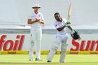 South Africa's Temba Bavuma celebrates his century as Stuart Broad watches on. Photo / AP