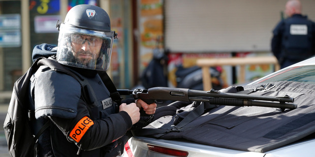 A police officer takes position after the fatal shooting. Photo / AP