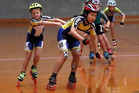 Eugenia Lee gets a push during the Junior Mixed pairs relay heats at Jubilee Stadium on Friday. Photo/ Stuart Munro