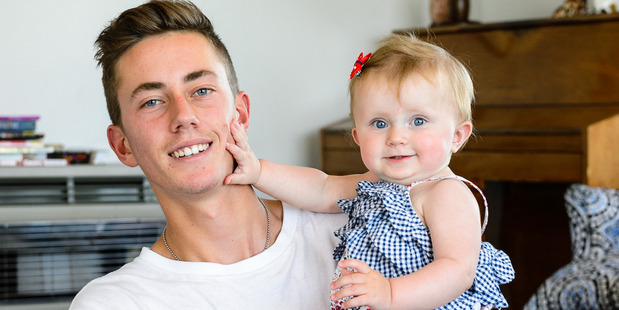 Noa Woolloff, 17, with his 9-month-old daughter Kyla in Plimmerton. Photo / Mark Coote