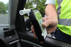 The new law cut the alcohol limit for drivers 20 and over from 400mcg of alcohol a litre of breath to 250mcg. Photo / Duncan Brown
