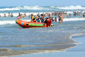 Surf rescue boat on patrol.