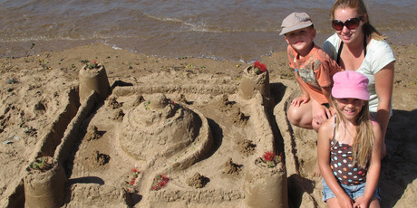 Kawakawa siblings Blake and Savannah Taylor, with Joanna Pietsch of Germany, opt for a classic sandcastle in last year's sandcastle competition, part of Paihia's Summer Festival. PHOTO/PETER DE GRAAF