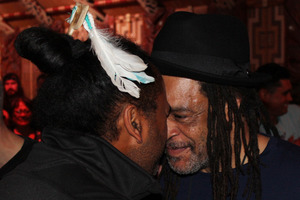 UB40 singer Astro and Treaty Grounds visitor experience manager Mori Rapana exchange a hongi. PHOTO /  Peter de Graaf