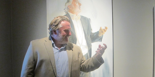 Acclaimed international tenor Simon O'Neill and his portrait by Felicity Priest which forms part of the exhibition at the Sarjeant Gallery. Photo/ Lin Ferguson