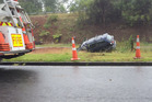 Car rolled down bank on Turret Rd in wet. Photo/George Novak