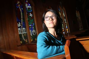 Maya Zhang, 26, from China, sits in St Mark's Church in Carterton. She had previously been taking her ease in the church when her bike and all her possession were stolen from outside the church. B