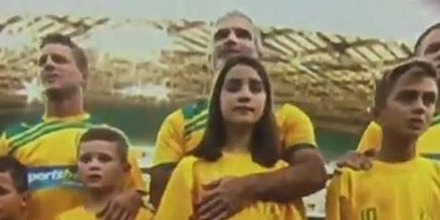 Craig Foster with his eight year-old daughter Charlie last night. Photo / YouTube.