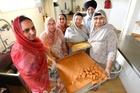 Gurdwara Sikh Sangat Tauranga members: Sandeep Kaur (left), Gyan Kaur, Ramandeep Kaur, Balbir Kaur, Puran Singh and Sukhdev Kaur preparing sweet treats for the street parade. Photo / George Novak