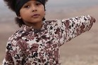 A screengrab from the video shows a young boy in military fatigues making threats to kill.