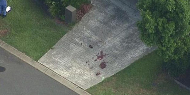 Blood seen on the drive outside a house on the street. Photo / 9 News