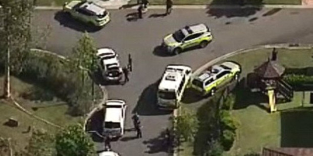 Police and ambulance vehicles clustered near the scene of the attack. Photo / 9 News