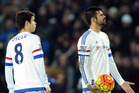 Chelsea's Diego Costa, right, and Oscar react during an English Premier League defeat. Photo / Ap