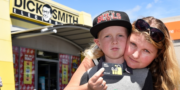 Te Puke mother Lisa Bay and her son Georgie, 8, were left disappointed after failing in their bid to get their $100 gift voucher redeemed at Dick Smith Tauranga yesterday. Photo / George Novak