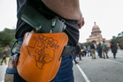 The rally of Texans with  handguns holstered on their hips to celebrate a new