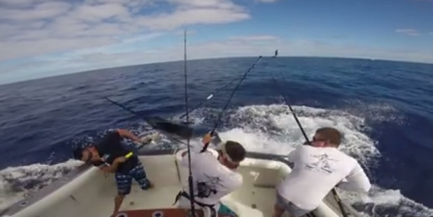 The man quickly jumped out of the way as the marlin came on board. Photo / Facebook