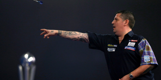 Scotland's Gary Anderson defended his world title despite the fact he might need glasses. Photo / AP