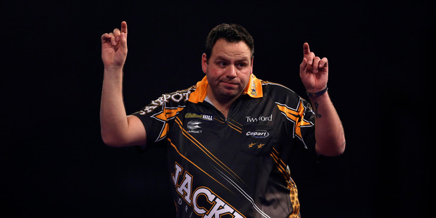 Adrian Lewis celebrates winning his semi final match against Raymond van Barneveld. Photo / AP