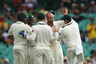 Australia's Nathan Lyon, center, is congratulated by captain Steve Smith, right, after taking the wicket of West Indies batsman Jermaine Blackwood. Photo / AP