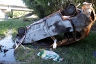 A burnt-out car has been left at a popular summer swimming spot. Photo / Paul Taylor