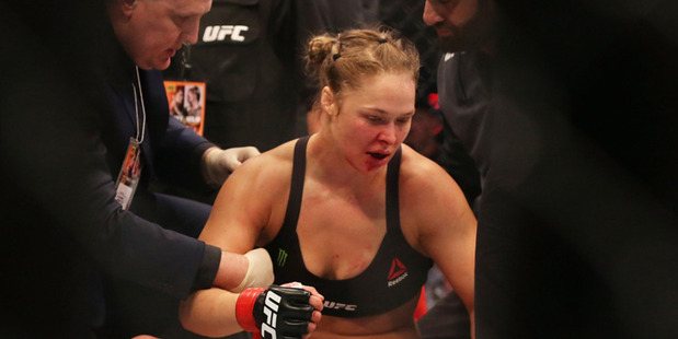 Ronda Rousey reacts after getting knocked out by Holly Holm. Photo / Getty