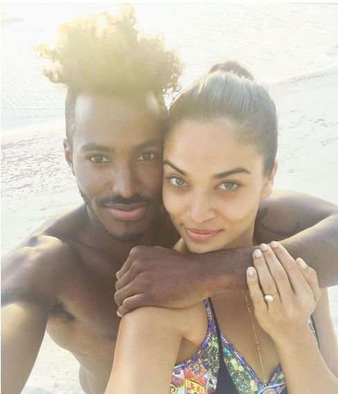 Victoria's Secret model Shanina Shaik accepted a proposal from DJ Ruckus on a private island.