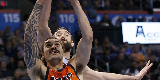 Oklahoma City Thunder center Steven Adams shoots in front of Memphis Grizzlies center Marc Gasol. Photo / AP